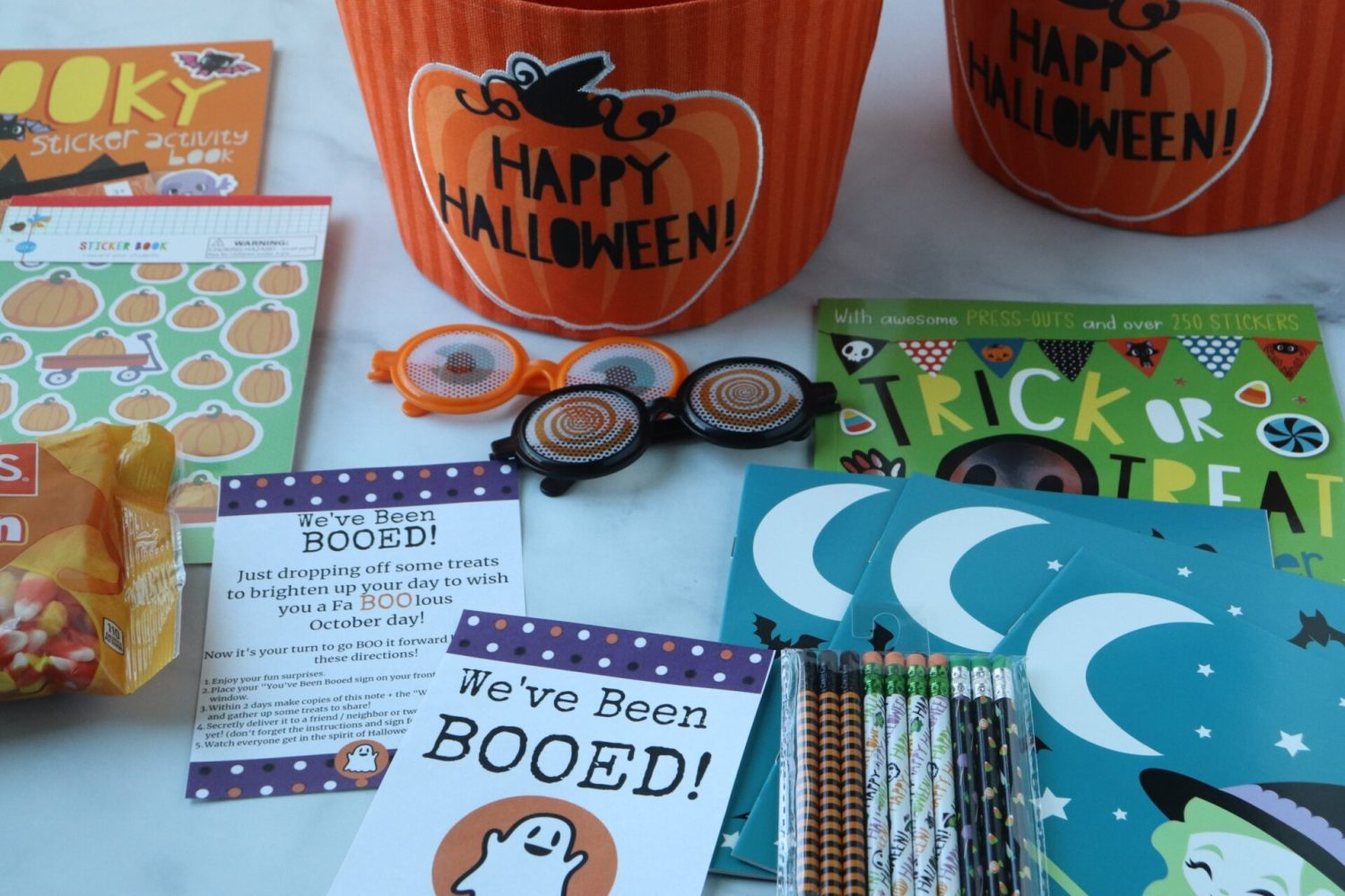 "Grab some treats and put on your running shoes as you and your family share the magic of Halloween as you go around dropping ""You've been booed"" surprises!"
