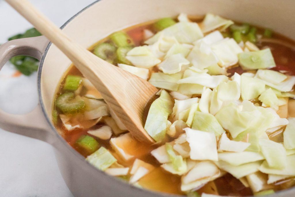 This vegetarian cabbage soup recipe is easy & delicious. It's a great way to eat healthily. Filled with all kinds of vegetables eating healthy never tasted so good!