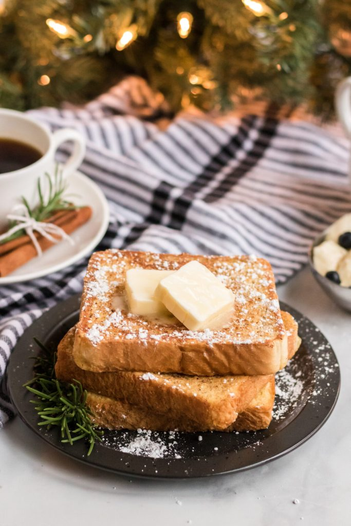 The best eggnog french toast recipe is here! This french toast recipe is soft on the inside and crispy on the outside perfect for weekends! This eggnog french toast served with a pat of butter and warm syrup will make your tastebuds rejoice!