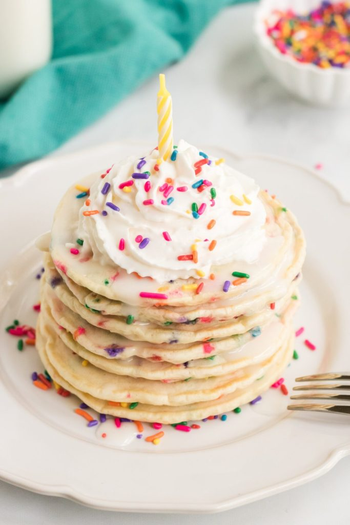 These are the best funfetti pancakes from scratch. These fluffy sprinkle pancakes will make everyone feel special every time they take a bite of them!