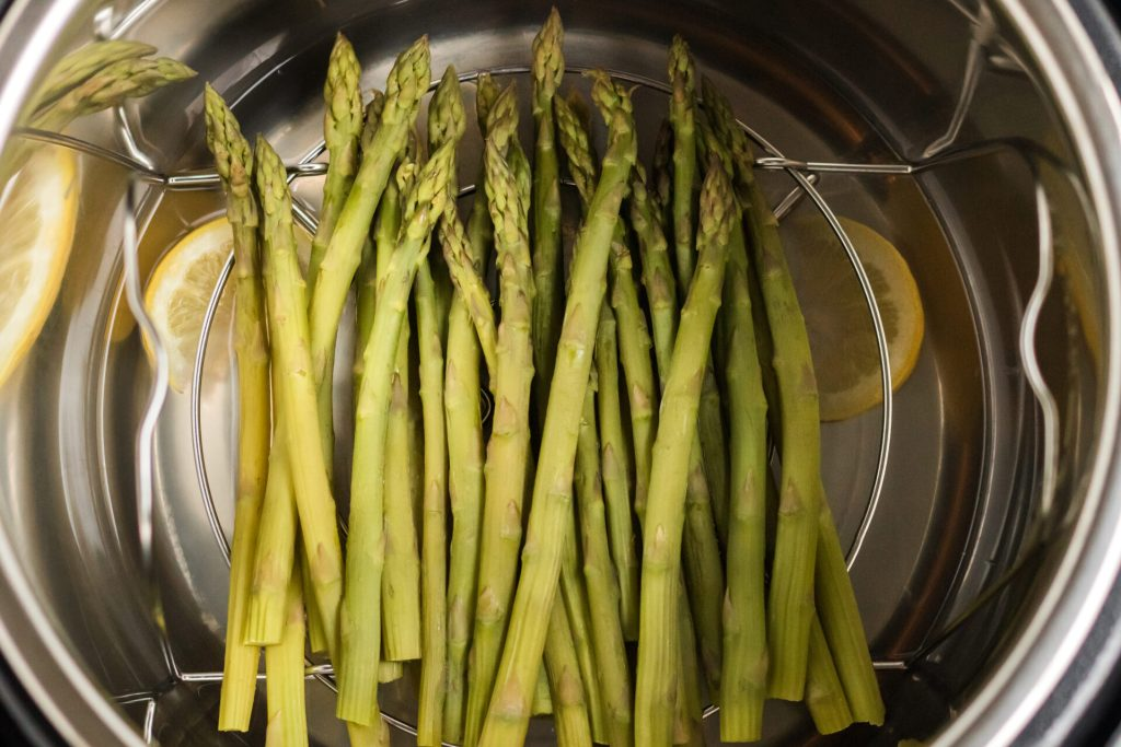 asparagus inside of instant pot on cooking rack
