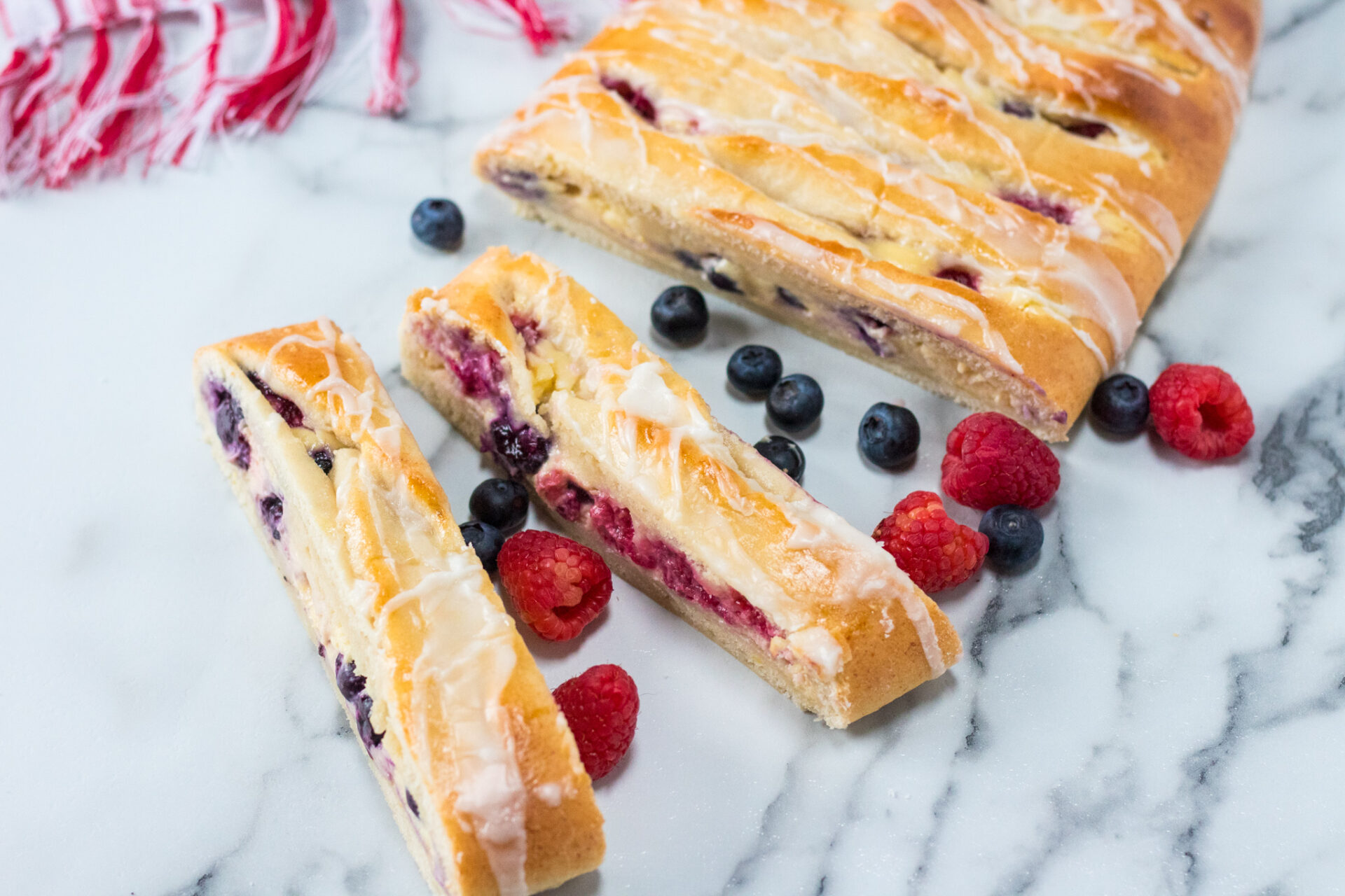 Enjoy a delicious family sized Berry Danish with all your loved ones! This Berry Danish takes just over an hour to prepare and will leave your mouth watering.