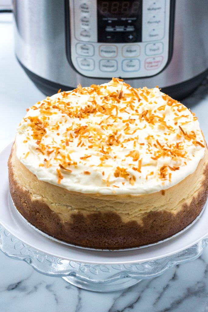 Try this Instant Pot Pina Colada Cheesecake recipe for a unique delicious spin on a classic favorite! The sweet creamy filling pairs perfectly with the tropical flavors in this simple Instant Pot recipe.