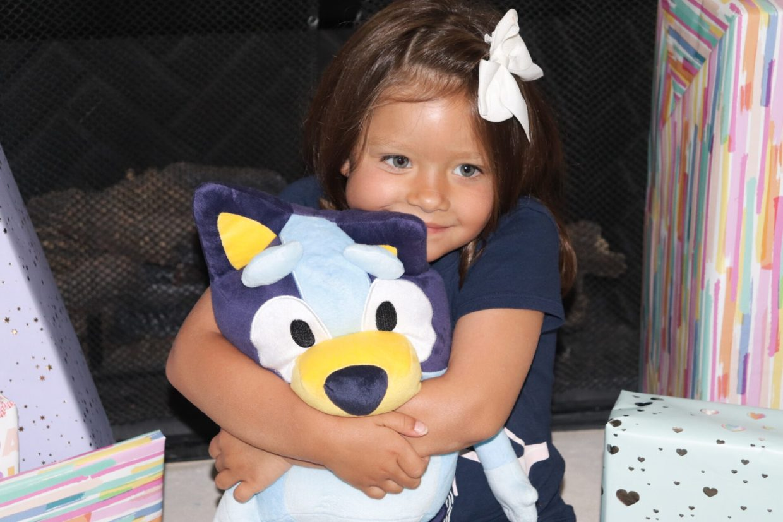 Talie loving on bluey