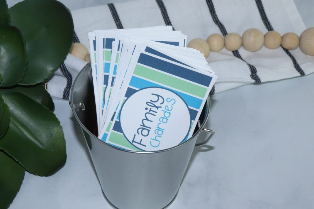 horizontal shot of family charade cards in a metal bucket
