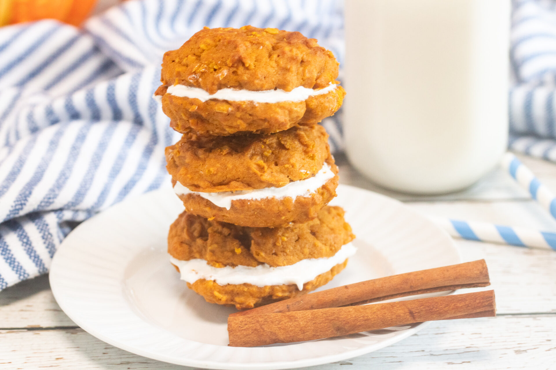 3 pumpkin whoopie pies stacked on top of each other