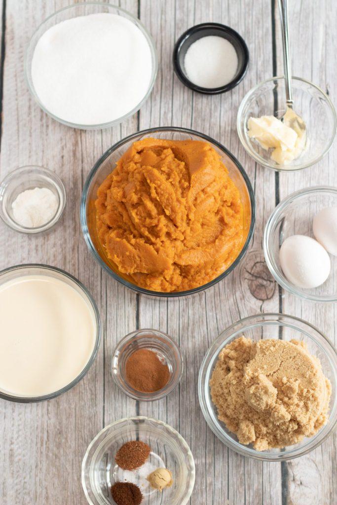pumpkin cobbler ingredients in assorted glass bowls