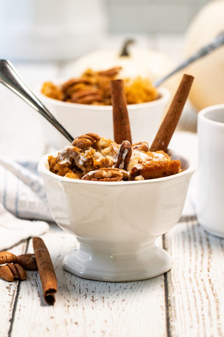 small dish of pumpkin cobbler with a spoon