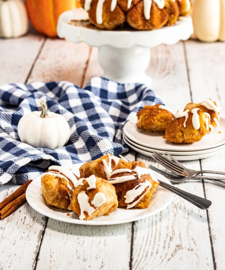 side shot of monkey bread on plates with fall decor
