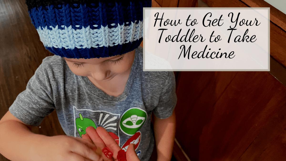 toddler taking medicine