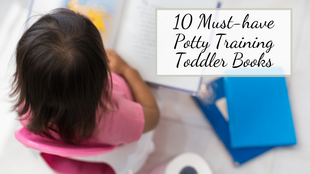 girl reading potty training books for toddlers on pink potty seat