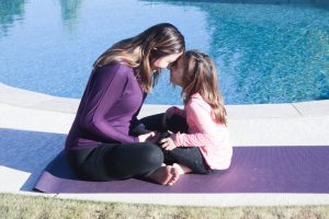 mom and daughter practicing mindfulness for kids together
