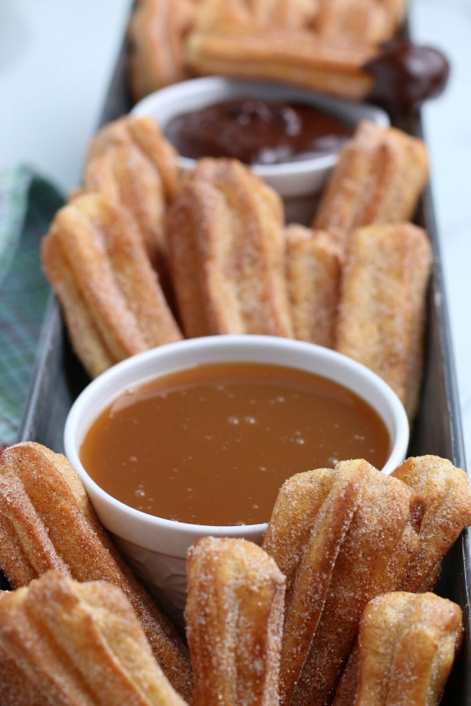 close up shot of air fryer churros and sauces