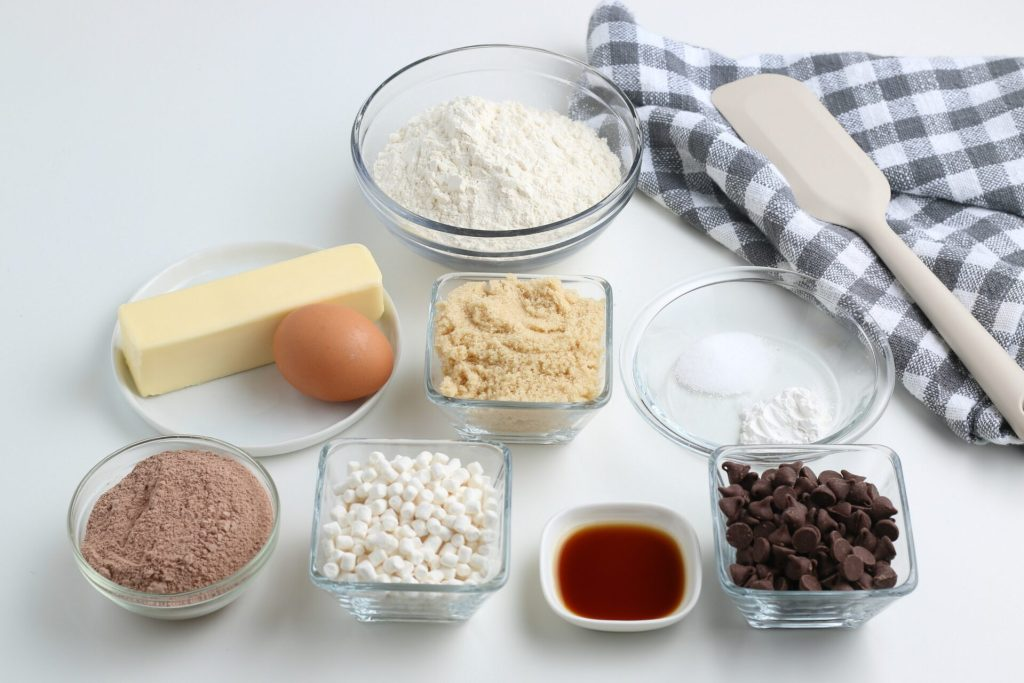 ingredients for hot chocolate cookies in glass bowls