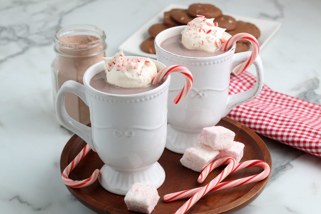 peppermint hot chocolate with whipped cream and candy canes