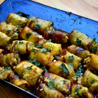 Baked Eggplant Rolls with Goat Cheese, Caramelized Onions and Pine Nuts