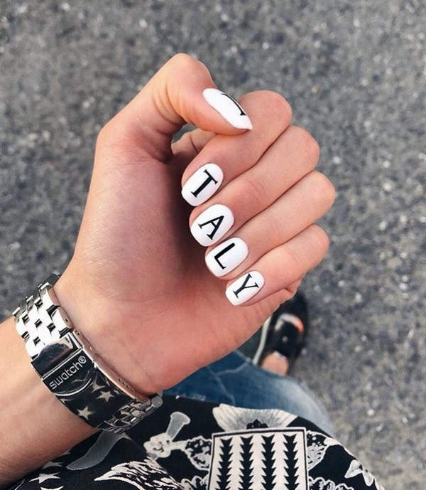 Stunning manicure with inscriptions 2018-2019 of the year: words on nails - photo ideas 12