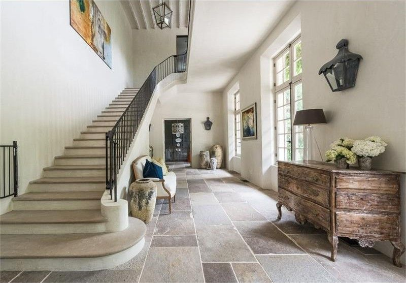 Youd Think The Stone Floors Whitewashed Wood Stairs And Neutral Color Palette Would Feel Cold But I Just Love European Charm Of This Foyer