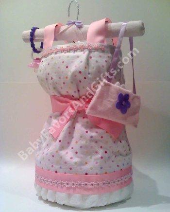 http://indulgy.com/post/ZN8XqdghX1/diaper-cakes-for-gir