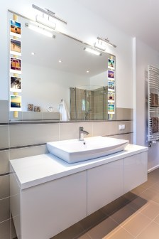 Bright space - a white modern ladies room with a big mirror