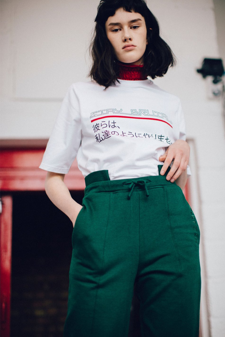 """White cotton t-shirt with stay brutal printed slogan and Japanese text reading """"They don't make them like us anymore"""". A statement empowering people to stay true to what they believe in."""