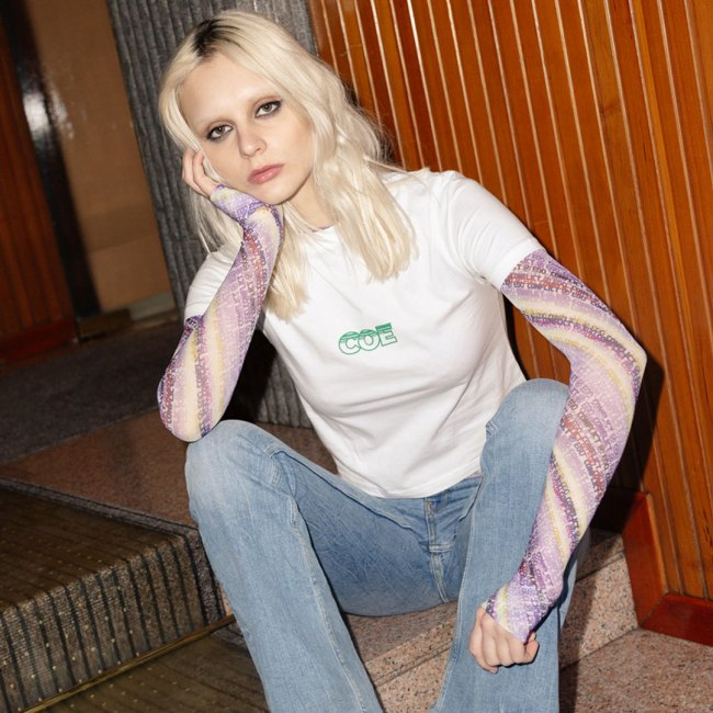 COE cotton white printed tee, worn over Dell long sleeve printed mesh top.