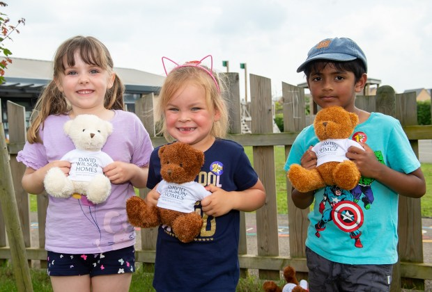 B&DWC - SGB_8740 - Three children with the bears donated by David Wilson Homes