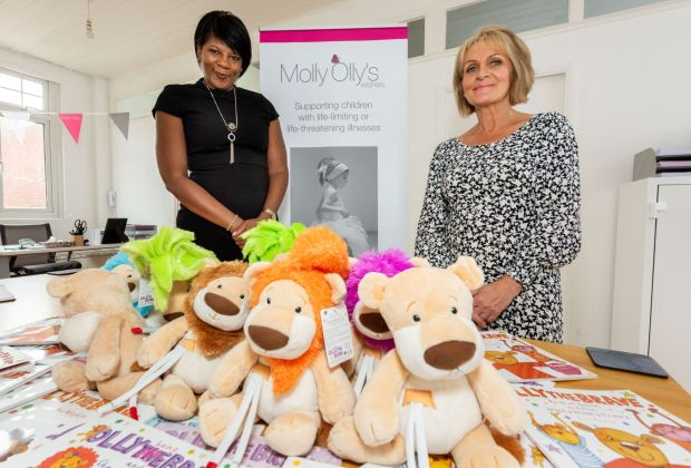 Jackie Evans from Molly Olly's and Angela Nurse from Bellway South Midlands at Molly Olly's Wishes' offices in Warwick (2)-5004090c