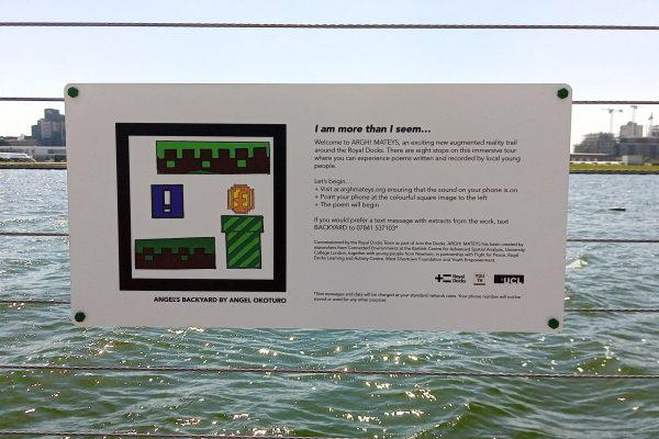 Photograph showing the installed sign with an AR marker designed by Angel Okoturo for her poem titled Angel's Backyard