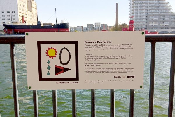 Photograph showing the installed sign with an AR marker designed by Ava Rogha for her poem titled I'm the River