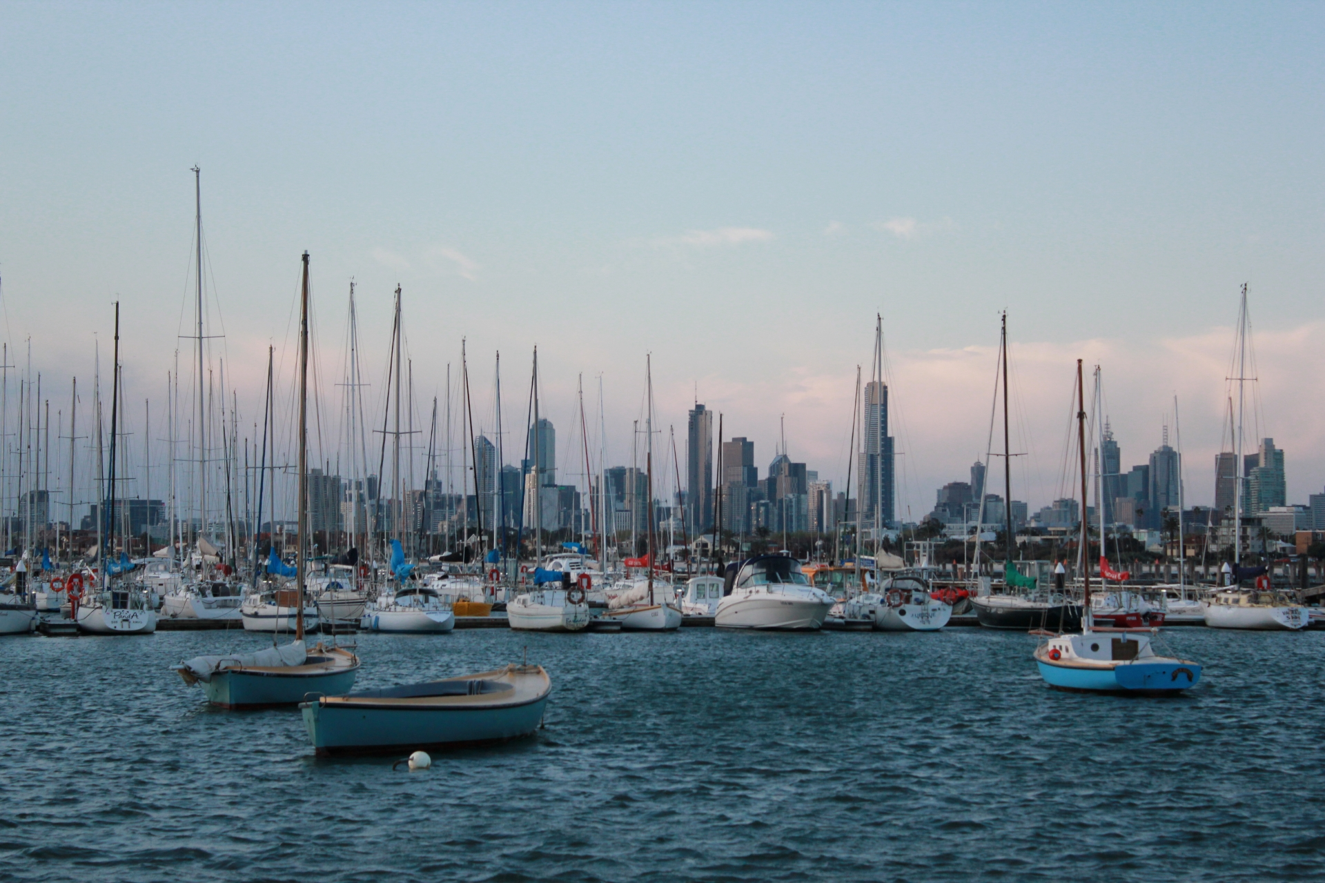 Boats lined up at St Kilda pier at sunset