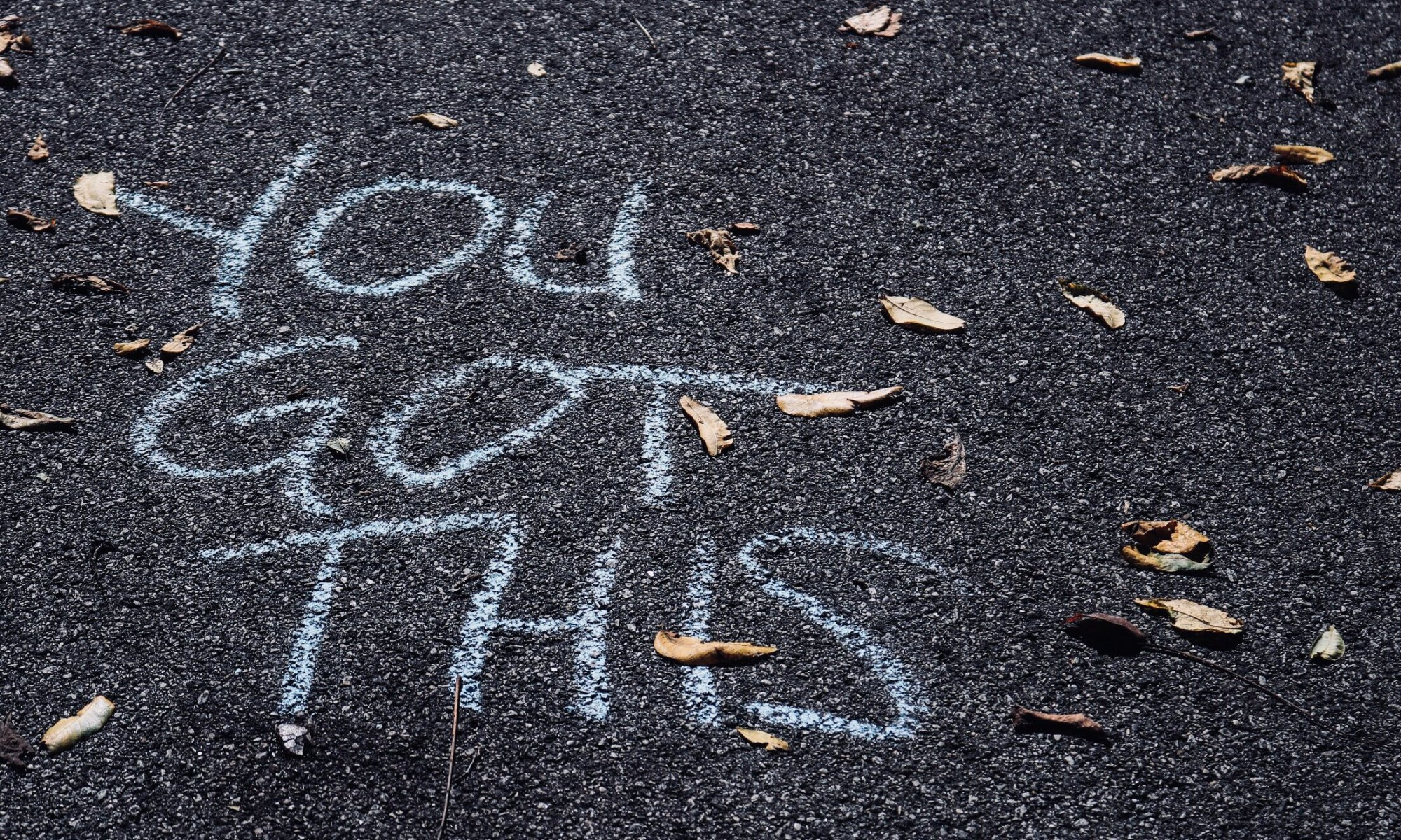 "Chalk words on sidewalk saying ""you got this"""