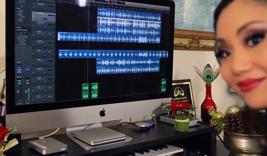 Cellist Tina Guo recording on her iMac-based home studio