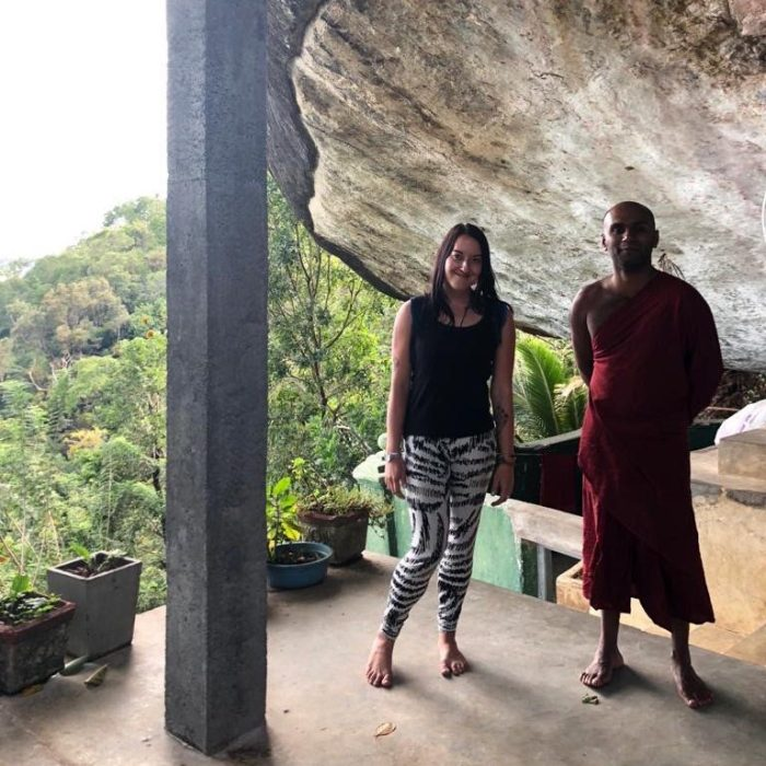Timi Orosz founder of Connect One Marketing in Sri Lanka with a monk learning to have balance