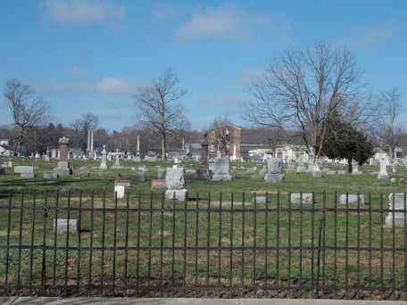 East side of the cemetery looking west, showing how close industry and homes are in Connersville.
