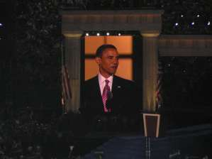 Barack Obama on large screen at Invesco