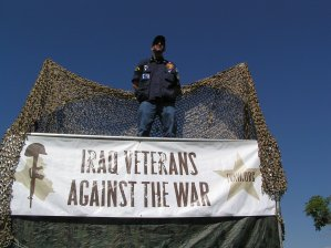 "Pinky Ornstein in Denver with banner saying ""Iraq Veterans Against The War"""