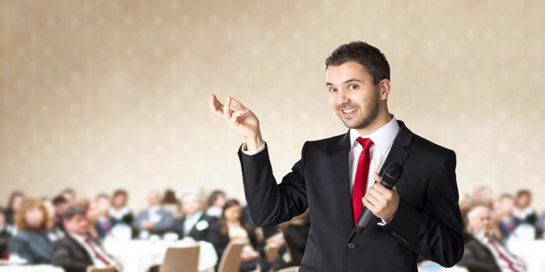 testimonials - man speaking to group image