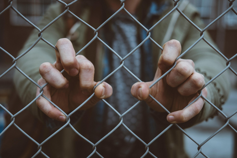 man behind fence   completion barrier   hakomi