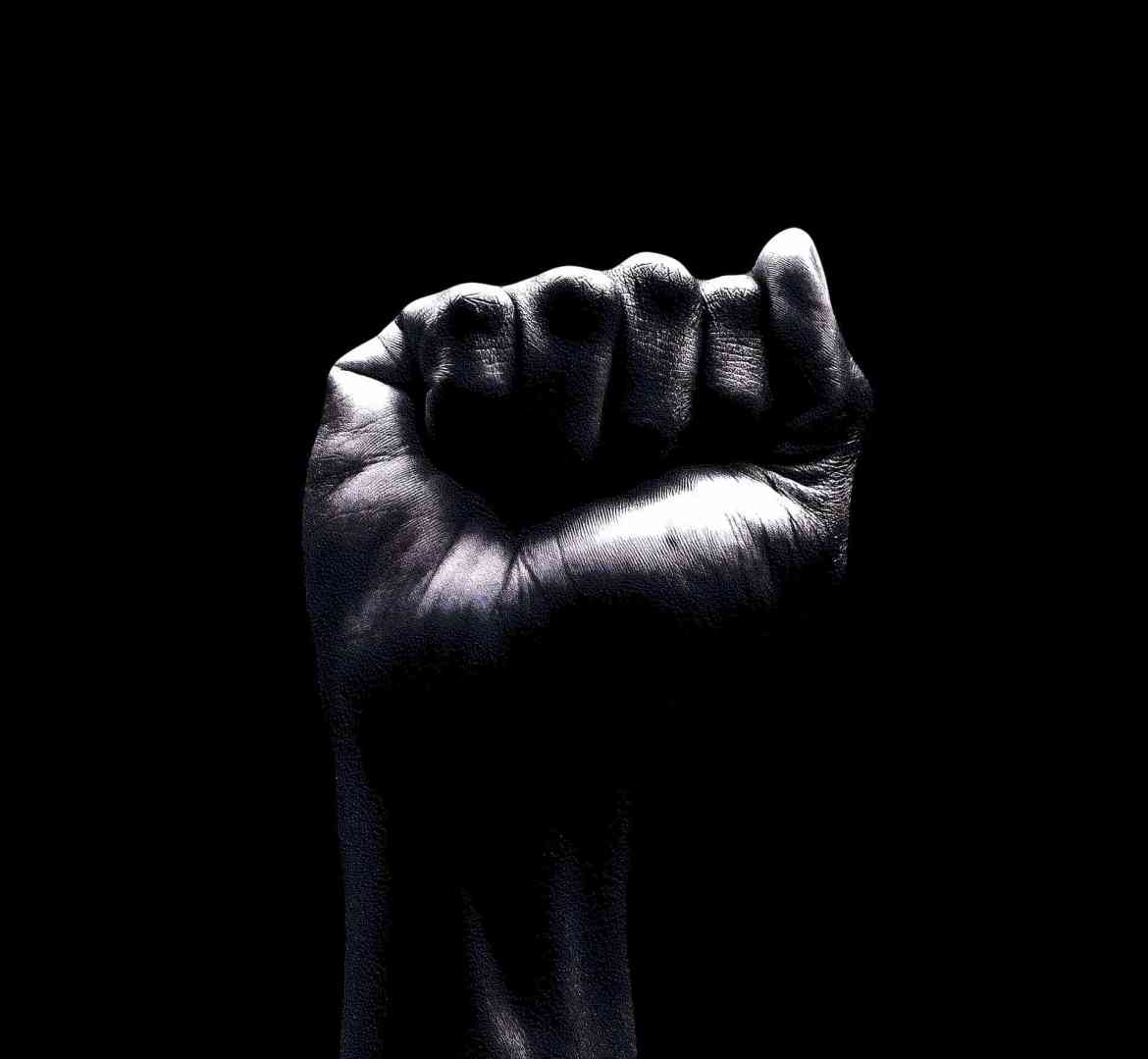 Black man's fist 2 showing respect for the Black Lives Matter movement | Energy of the new moon in Aquarius February 2021 | Conscious Content
