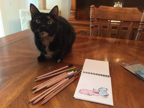 Everyone's a critic. Allegra, supervising my coloring.