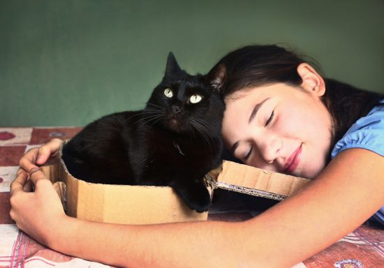 girl-hugging-black-cat