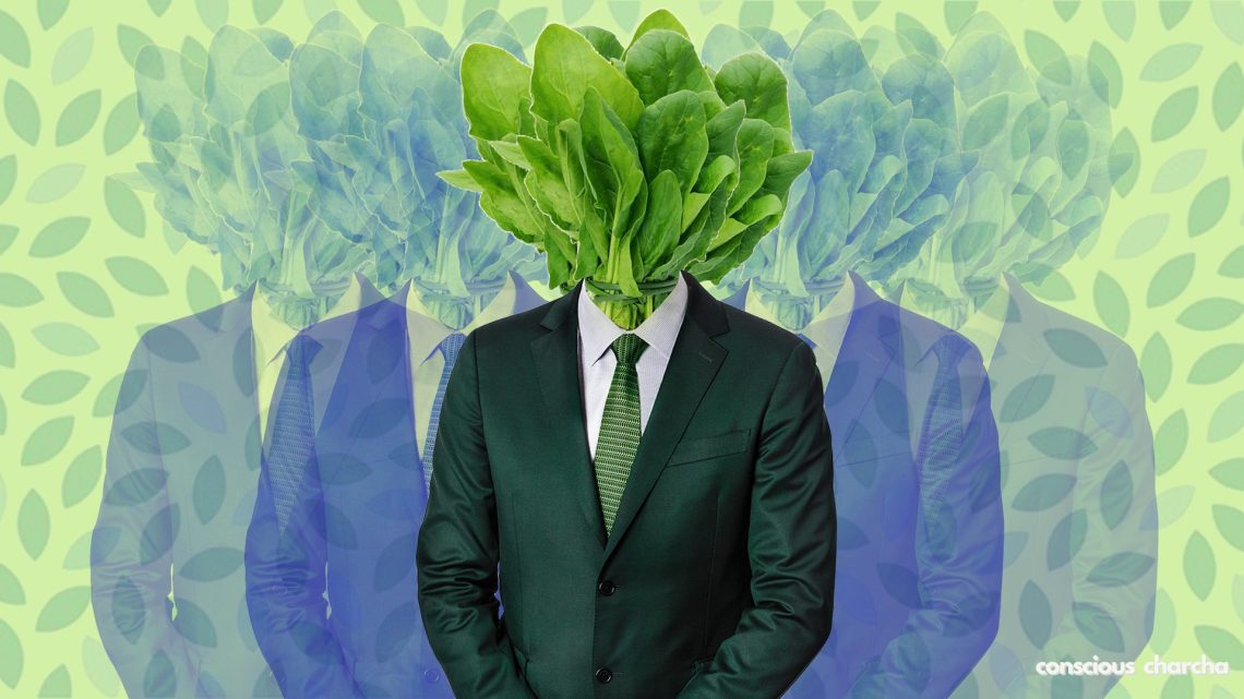 Veganism- A lifestyle movement. Man with spinach instead of head to show vegan state of mind