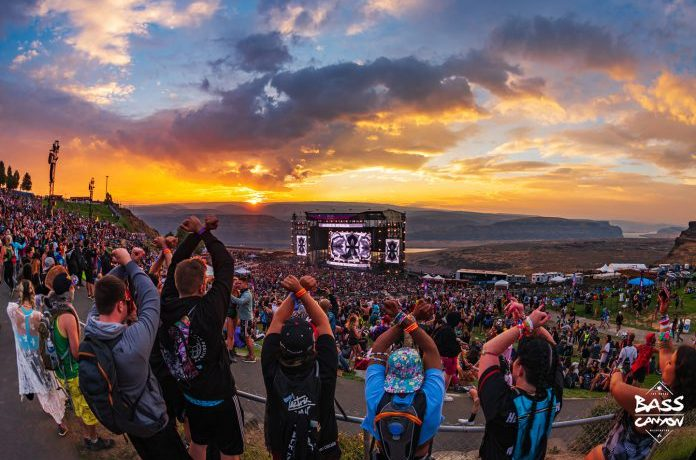 Fans throw up X at Excision's Bass Canyon at The Gorge - scenic view of the stage