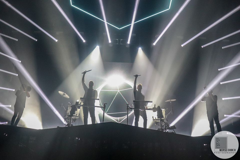ODESZA poses with horns section on Moment Apart tour