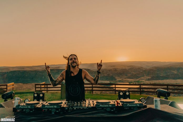 Seven Lions DJs at The Gorge Amphitheatre with sprawling nature views at sunset