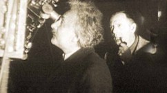 Einstein with Edwin Hubble, in 1931, at the Mount Wilson Observatory in California, looking through the lens of the 100-inch telescope through which Hubble discovered the expansion of the universe in 1929. Courtesy of the Archives, Calif Inst of Technology.