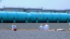 Workers at TEPCO's Fukushima Daiichi Nuclear Power Station work among underground water storage pools on 17 April 2013. (Photo: Greg Webb / IAEA)