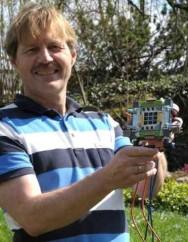 IBM scientist Dr. Bruno Michel holds the receiver design package (Photo: IBM)