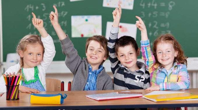 schoolchildren-raising-their-hands